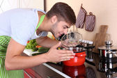 Handsome man cooking — Stock Photo