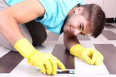 Young man cleaning floor — Stock Photo