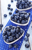 Delicious blueberries on table — Stock Photo