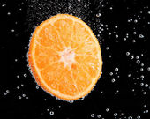 Fresh orange in water bubbles — Stock Photo