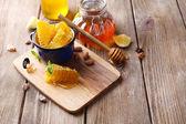 Fresh honey on wooden table — Stok fotoğraf