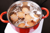 Eggs in boiling water — Stock Photo