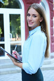 Beautiful businesswoman with notebook — Stock Photo