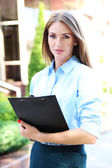 Beautiful businesswoman with notebook — Foto Stock