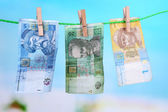 Ukrainian hryvnia bills hanging on rope — Stock Photo
