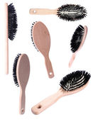 Collage of wooden hairbrushes isolated on white — Stock Photo