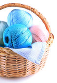 Colorful yarn balls for knitting in wicker basket, isolated on white — Stock Photo