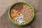 Cereals in bowl on burlap background — Stok fotoğraf
