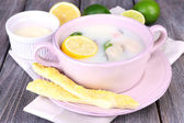 Tasty soup with oysters on wooden table — Stock Photo