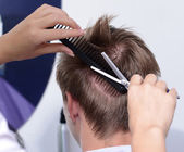 Young man in beauty salon — Zdjęcie stockowe