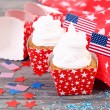 American patriotic holiday cupcakes on wooden table — Stock Photo #51172615