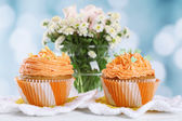Tasty cupcake on table, on bright background — Stock Photo
