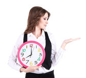 Young business woman with clock isolated on white — Stock Photo