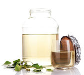 Glass and large flagon of fresh birch sap  isolated on white — Stock Photo