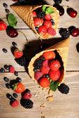 Different ripe berries in sugar cones — Stock Photo