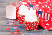 American patriotic holiday cupcakes on wooden table — Stock Photo