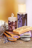 Spa still life with lavender oil and flowers on wooden table, on light background — Foto Stock