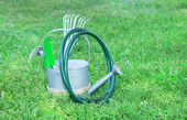 Garden tools on green grass background — Stock Photo