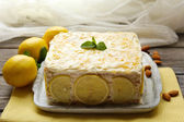 Tasty lemon cake on table at home — ストック写真