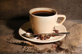 Cup of coffee on rustic wooden background — Stock Photo