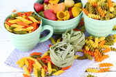 Colorful pasta in color bowls — Stock Photo