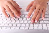 Female hands typing on keyboard — Stok fotoğraf