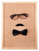 Glasses, mustache and bow tie forming man face — Stock Photo