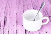 Empty cup with tea spoon — Stock Photo