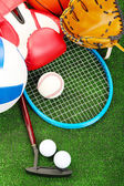 Sports equipment on grass — Stock Photo
