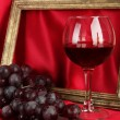 Composition of frame,wine and grapes on bright background — Stock Photo #51221771