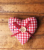 Fabric heart with color pins — Stock Photo