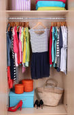 Colorful clothes in wardrobe — Stock Photo