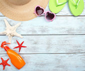 Few summer items on wooden background — Stockfoto