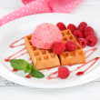 Tasty belgian waffles with ice cream on wooden table — Stock Photo #51230695