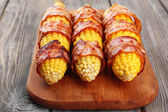 Grilled bacon wrapped corn on table, close-up — Stock Photo
