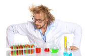 Crazy scientist working with tubes — Stock Photo