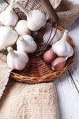 Fresh garlic in basket — Stock Photo