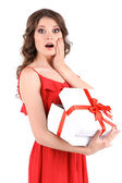 Beautiful young girl in red dress with gift isolated on white — Stock Photo