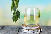Glass of fresh birch sap — Stock Photo