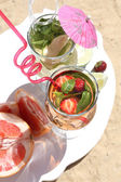 Delicious cocktails on beach, close-up — Stock Photo