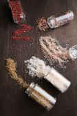Different sea salt scattered on table, close up — Stock Photo