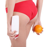 Young woman with orange and cream — Stock Photo