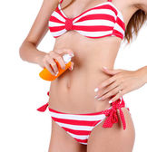 Woman in swimsuit with sunscreen — Stok fotoğraf