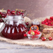 Berries jam in glass jar on table, close-up — Stock Photo #51287739