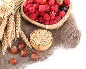 Wooden bowls of berries on sackcloth isolated on white — ストック写真