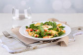 Green salad with apples, walnuts and cheese on light background — Stock Photo