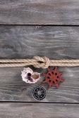 Marine knot on wooden background — Stok fotoğraf