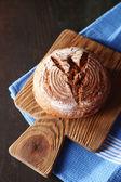 Fresh bread on dark wooden background — Stock Photo