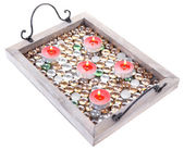 Candles on vintage tray with decorative stones, isolated on white — Stock Photo