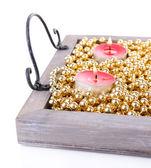 Candles on vintage tray with decorative beads, isolated on white — Stock Photo